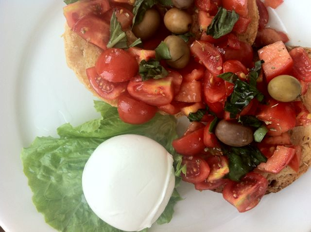 Friselle (toasted bread) with tomatoes and mozzarella.